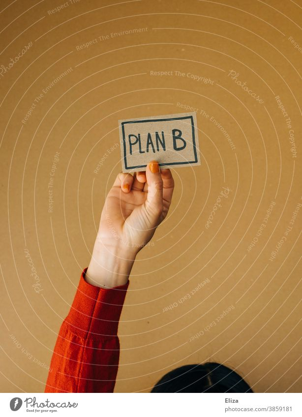 Woman holding a sign with the word plan B written on it Plan B alternative Flexibility planning change Alternative freelance Safety Planning Word authored