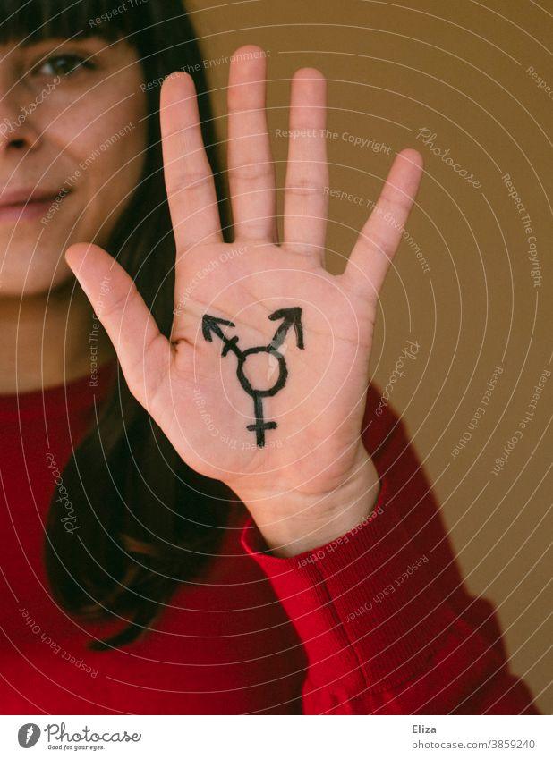 A woman holds up her hand, on which the transgender symbol is painted Transgender equal rights Tolerant Freedom Pride LGBTQ variety Equality Gender
