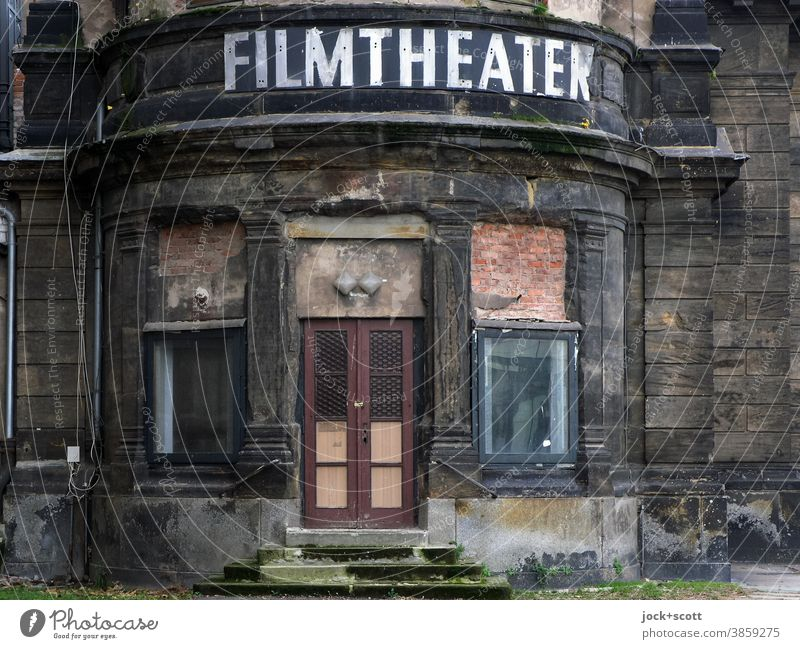 obvious decline of the age of the film theatre Past Ruin Entrance in need of rehabilitation Downfall Historic Decline lost places Architecture Change