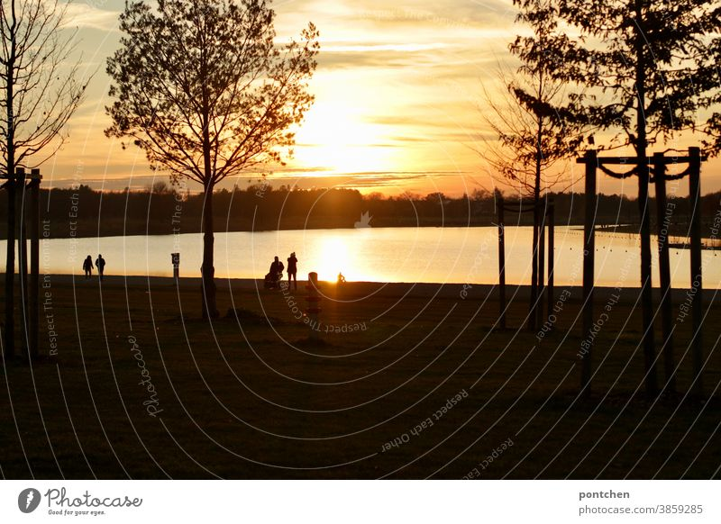 Romantic atmosphere at the lake at sunset. Walkers at the lake. Landscape Sunset Lake romance Autumn strollers Clouds Sky Nature Evening Dusk Water Relaxation