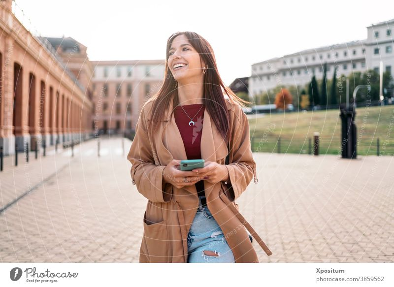 Young caucasian woman using smartphone laughing happy people madrid portrait city lifestyle young urban travel beautiful happiness smile spain mobile person