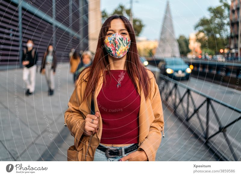 Young caucasian woman using facemask portrait happy people madrid city lifestyle young urban travel beautiful happiness smile spain mobile phone person fashion