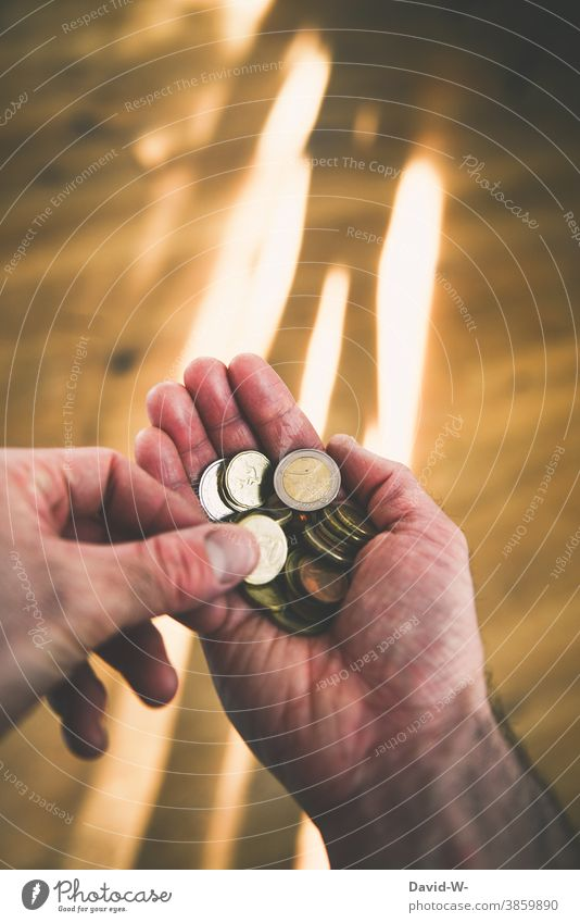 Man counts money Money Numbers € Euro Coins Hand stop Poverty finance Economy Income Light Loose change Save