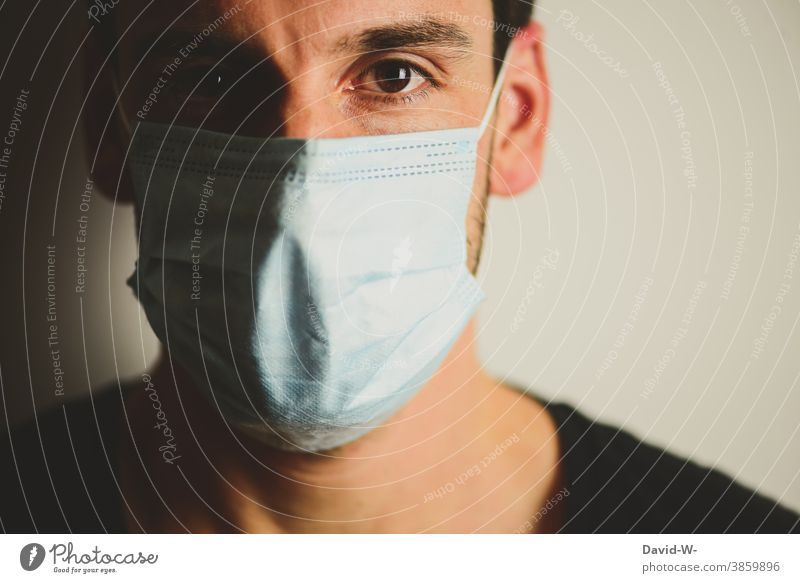in times of Corona coronavirus Respirator mask Man mouthpiece obligation Mask Security pandemic guard sb./sth. Fear Face Emotions