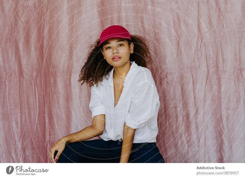 Young ethnic woman in trendy outfit style fashion cap confident afro casual cloth millennial female african american black headwear young individuality brunette
