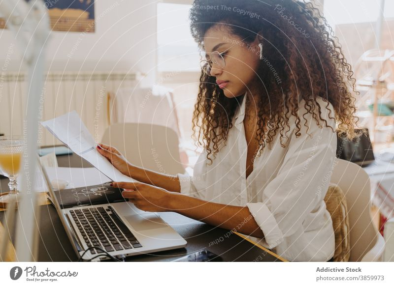 Ethnic woman doing paperwork at home accountant freelance document financial entrepreneur office female ethnic table business job bookkeeper professional