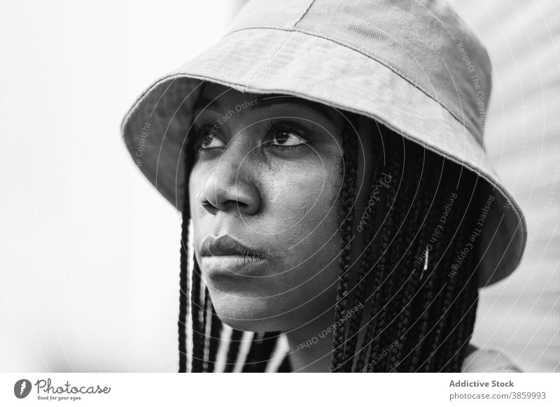 Young black woman in hat style casual appearance urban modern summer outfit young portrait braid female african american ethnic model hipster individuality