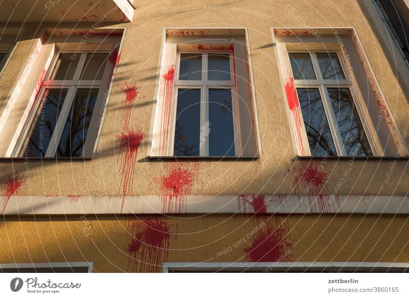 Further red spots of paint on a facade Colour Patch of colour paint bag blob splotch of paint Vandalism expression of opinion Bad mood Attack communication