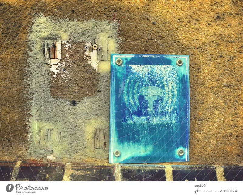 Interference noises sign Siren Old worn-out dilapidated Wall (building) screwed on Detail Long shot Trashy Deserted Exterior shot Colour photo