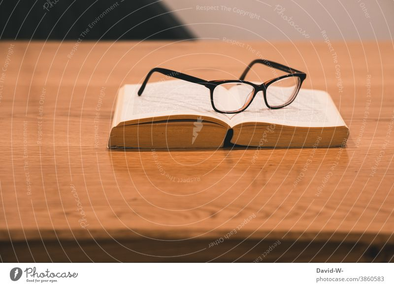 Book and glasses are on a table Break time-out Eyeglasses Reading Study Academic studies School tranquillity Leisure and hobbies