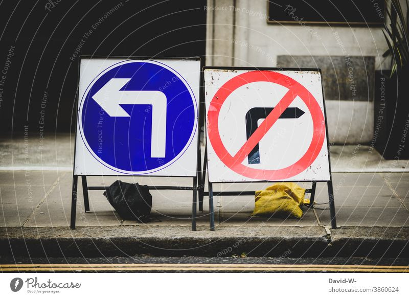 Arrows left commanded & right prohibited Road traffic Road sign Left Right interdiction Street Transport groundbreaking