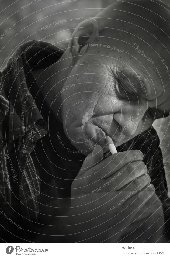 Portrait of a smoker Man Smoking smoking Cigarette Ignite portrait Face Addiction enjoyment relaxation habit Dependence Nicotine Health hazard