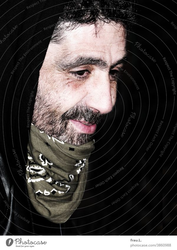 A smiling man Man Sit good-looking Attractive portrait Neckerchief Facial hair Hooded (clothing) Respiratory protection coronavirus SARS-CoV-2
