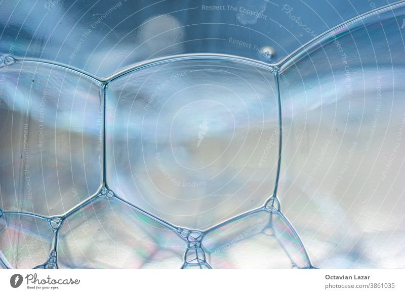 Abstract rectangular shaped soap bubbles in plastic bottle macro close up front view tungsten square liquid water foam background closeup texture wet clear