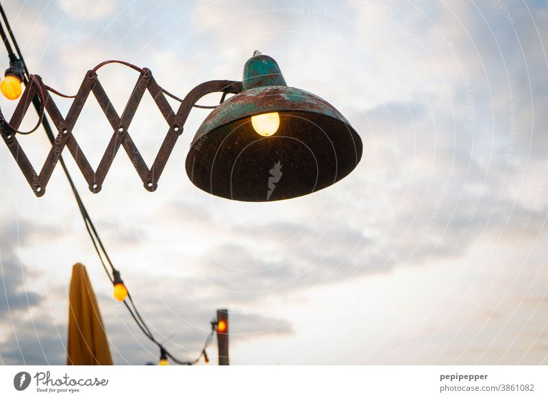 old lamp at the beach of Holland Lamp Light Things Street lighting Beach Sunshade Electric bulb Lamplight pears Artificial light Colour photo Illuminate