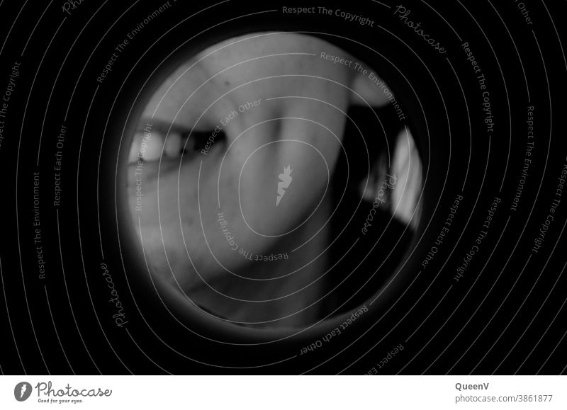 Smile of a girl with dimple in black and white, seen through a round hole smile woman dimples on the cheek circle 18-25 years Young woman Adults 18 - 30 years