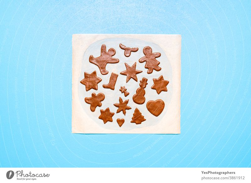 Gingerbread cookies dough cut in different shapes on a blue table. Baking Christmas cookies Christmas baking Merry Christmas above view advent cookies bake