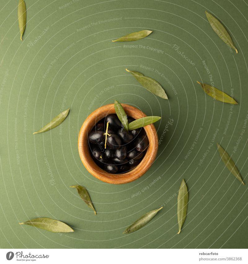black olives, on green background fresh healthy food leaf ingredient greek organic vegetarian extra oil yellow fruit spain plant closeup raw natural virgin