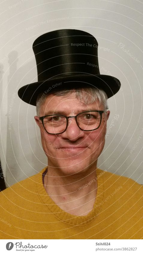 Chapeau! - Man in his fifties with a black top hat Cylinder Hat Black chapeau Sweater Yellow mustard yellow Eyeglasses Laughter fun Circus Theatre Classic