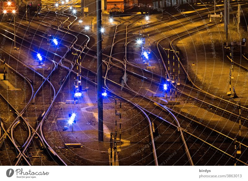 Goods station with many tracks and switches. Lights. Night shot. Railway Railroad system Freight station Railroad tracks Switches Logistics Many clearer curves