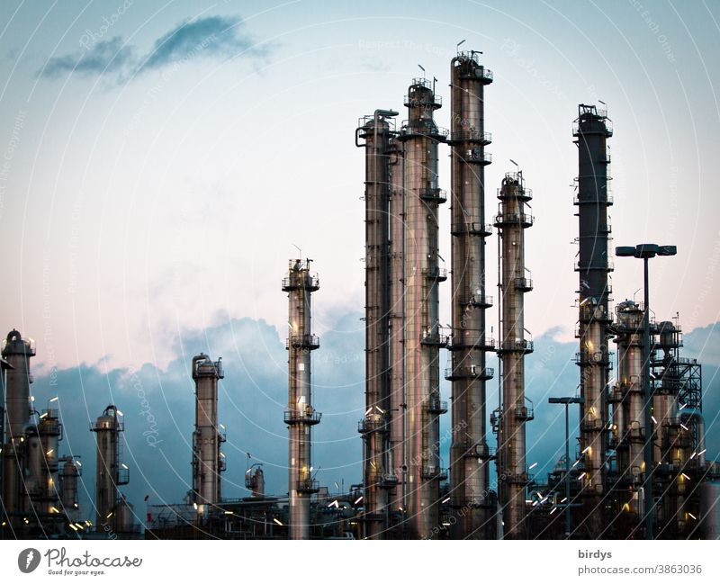 Chemical industry, industrial plant with metal pipes and chimneys. Lights, evening Industrial plant Chemical Industry Metal Chimney Factory