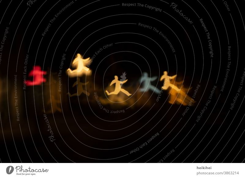 Dancing light men Light Light (Natural Phenomenon) Human being little man Dance Hop Running Walking Jump Joy Movement Enthusiasm bokeh effect Yellow Red Blue