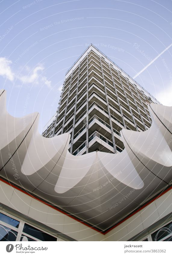 Architecture with corners and edges GDR Downtown Berlin High-rise Facade Sharp-edged Tall Retro Corner Structures and shapes Symmetry Worm's-eye view
