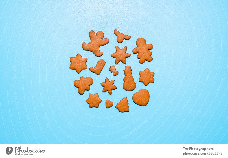 Gingerbread cookies in different shapes on a blue background. Homemade Christmas cookies Christmas baking Merry Christmas above view advent cookies baked