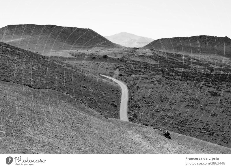 Volcanic landscape on Lanzarote Volcano Landscape Black & white photo Exterior shot Vacation & Travel Deserted Island Mountain Nature Far-off places
