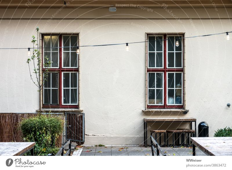 Otherwise a popular place for feasting and dancing Building Window Fairy lights Garden Terrace garden decoration sit out feed sb./sth. Tavern Gastronomy