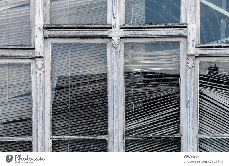Behind this window, there's no movement for a long time Window Window frame Weathered Old Ornate Venetian blinds obliquely Broken Glass reflection