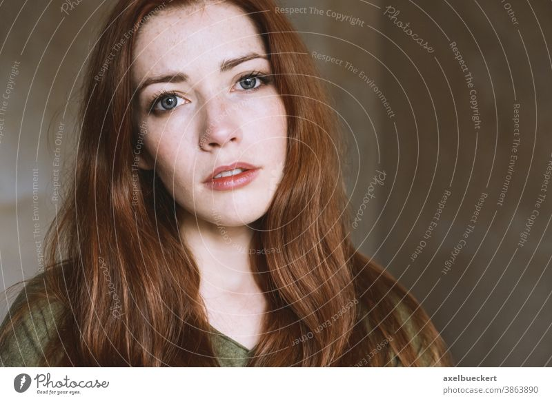 young woman in empty room with natural light real people portrait Young woman naturally Dreamily Red-haired Woman Adults Long-haired Freckles
