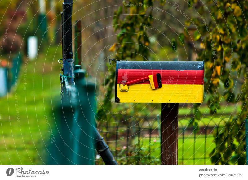 Mailbox for German letters Americas Germany Flag German flag nation national colors Patriotism patriotically National national emblem Garden allotment