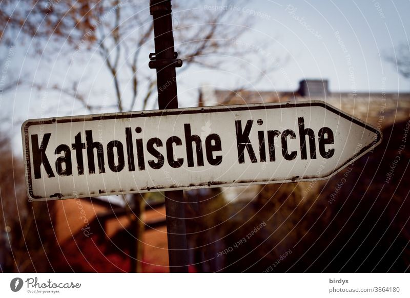 """Directional road sign with the inscription """" Catholic Church """". Catholic Church Catholicism celibacy Abuse somber writing Cover-up sanctimoniously Archaic"""