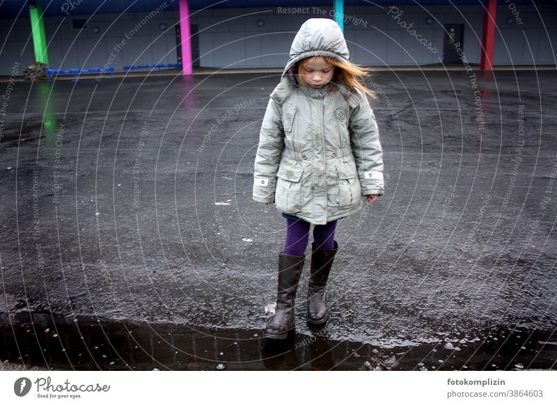 Child stands alone in a schoolyard Girl Schoolyard Infancy Human being Parenting Schoolchild on one's own by oneself Life Empty Loneliness Lonely children