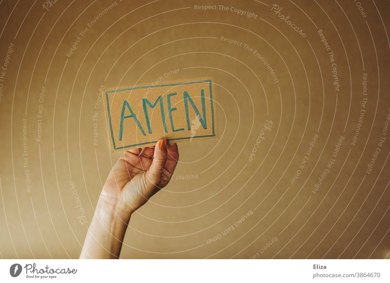 Person holds a sign with the inscription Amen amen Church Heart Prayer pray Religion and faith religion Christianity Judaism praying Love Belief believe Holy