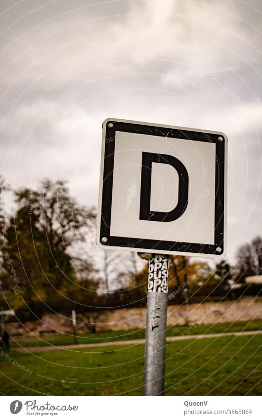 Shield with letter D Letters (alphabet) sign Signs and labeling Elbufer Signal Signage Word Exterior shot Typography communication Characters Compromise