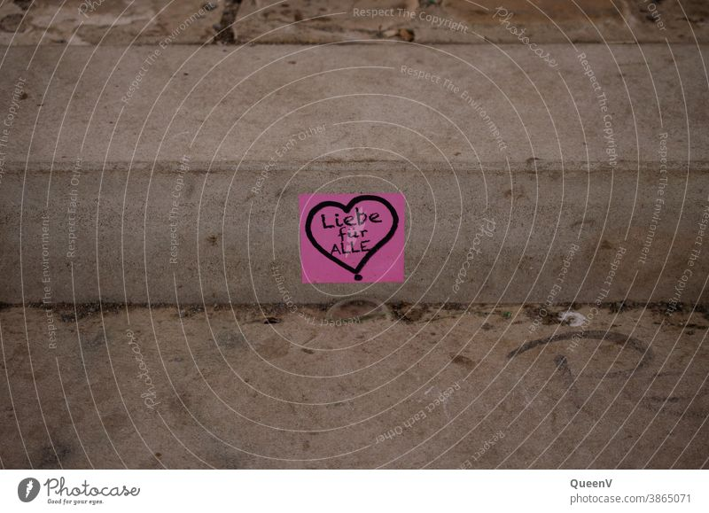 Pink sticker with heart, stuck in a staircase on the street stickers Street art street art Heart Love Art Work of art Graffiti Characters Creativity Sign