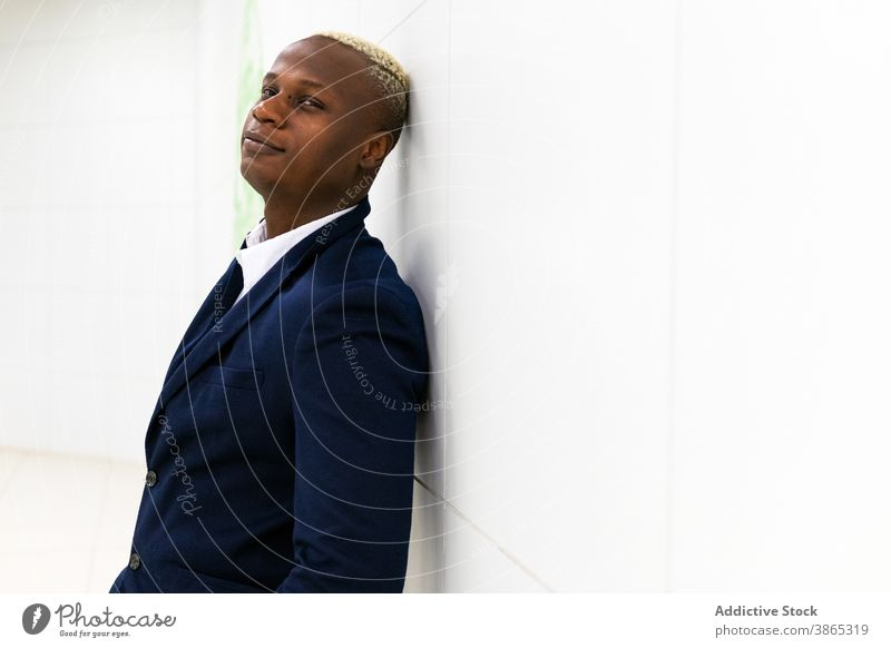 Black businessman in formal outfit in hallway confident suit well dressed costume entrepreneur corridor professional style male ethnic black african american