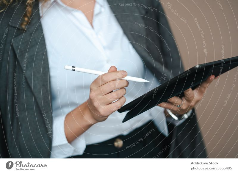 Focused businesswoman using tablet in studio project success close up entrepreneur anonymous focused achieve female formal work job outfit occupation internet