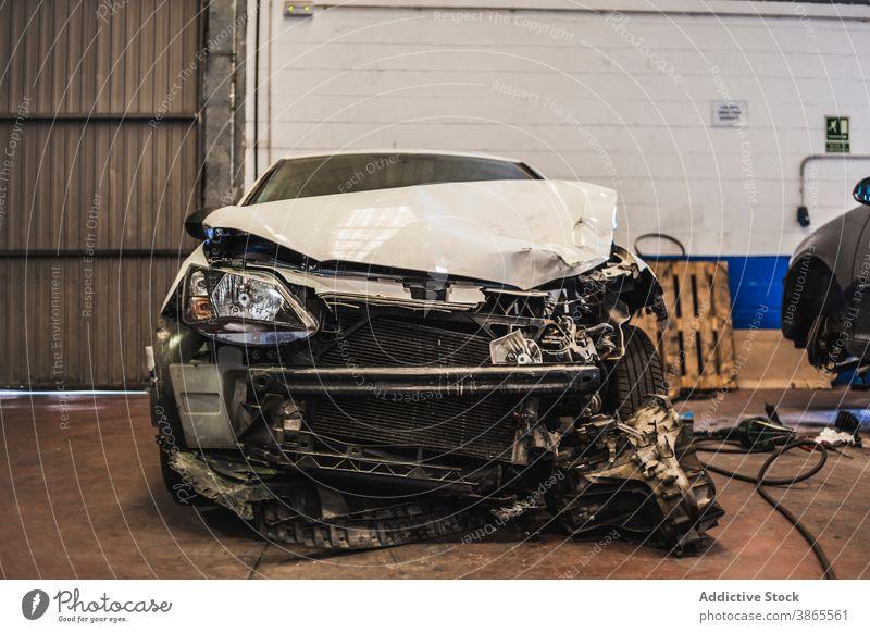 Crashed car inside spacious garage crash professional damage parked front modern maintenance service auto fix workshop repair transport vehicle industry wreck