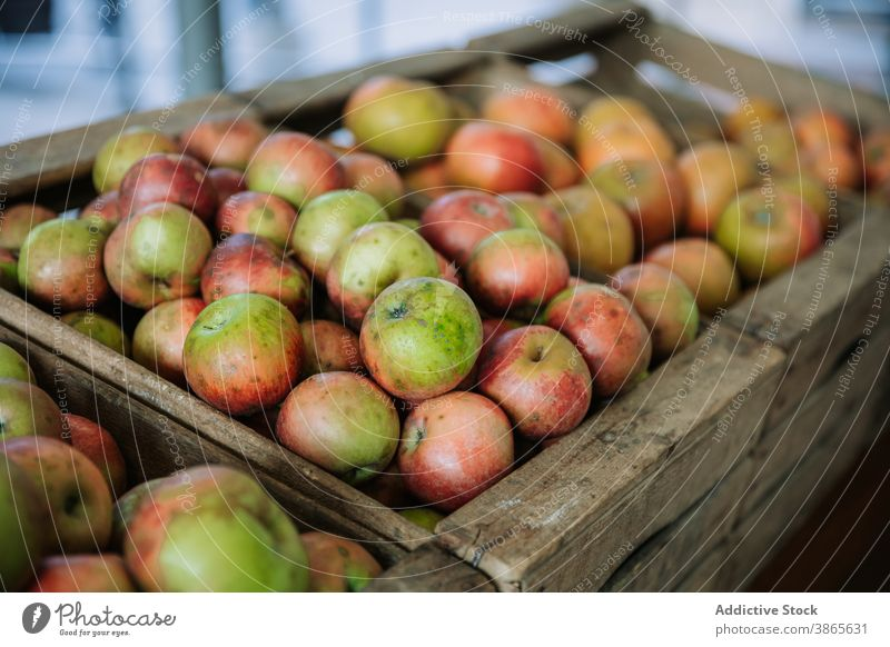 Organic ripe apples in wooden box fresh organic natural bio market harvest food fruit healthy nutrition grocery product vitamin agriculture retail container