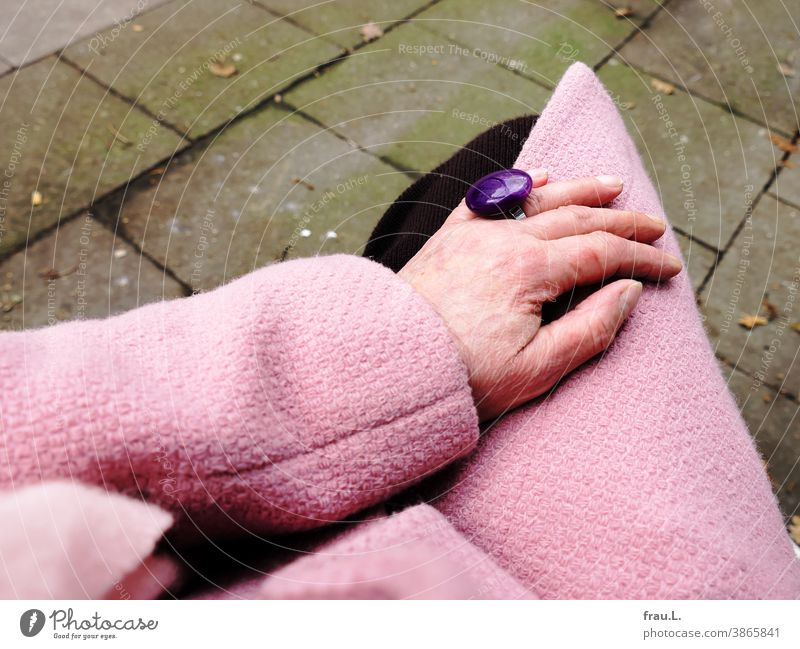 Old woman's hand with pink coat, pink scarf and purple ring and small hangover scratch Hand Human being Knitted skirt Fashion Finger Ring Costume jewelry