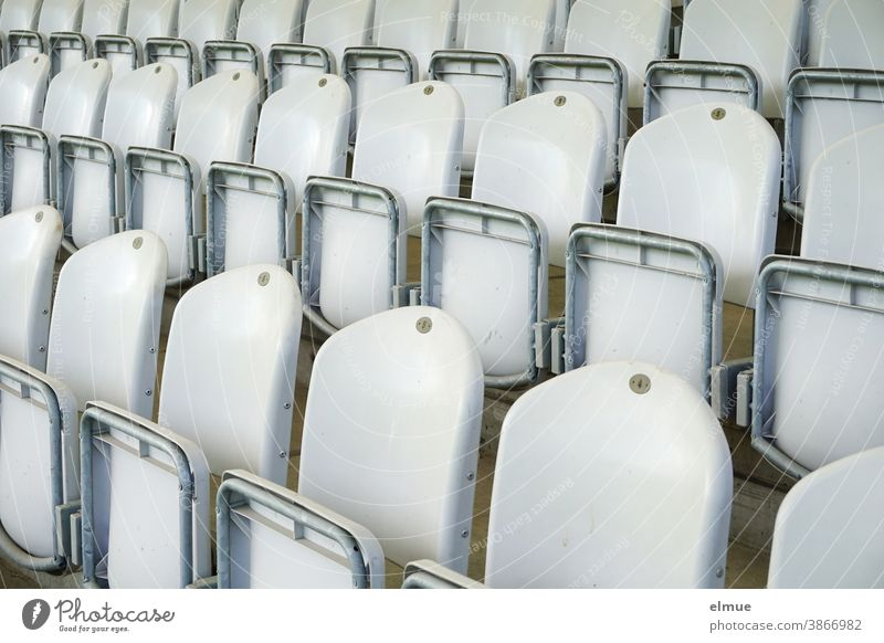 empty rows of seats in a grandstand / plastic chairs / seating Stands Grandstand Plastic chair Chair grandstand Empty plastic seats Auditorium flipped up
