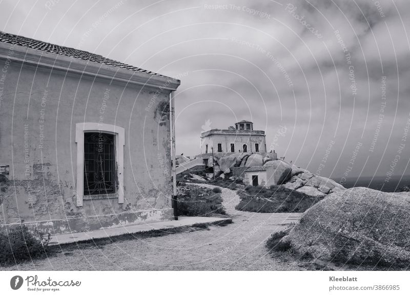 Black and white photo - way to an old lighthouse on Sardinia Capo Testa in a rainy sky Lighthouse Black & white photo rain-laden sky Ocean Vacation & Travel