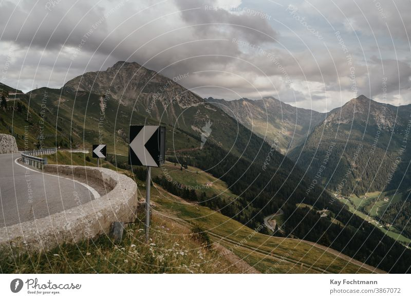 scenic mountain road with curve signs alp alpine alps asphalt austria car country curved day driving empty europe european highway hill holiday horizontal