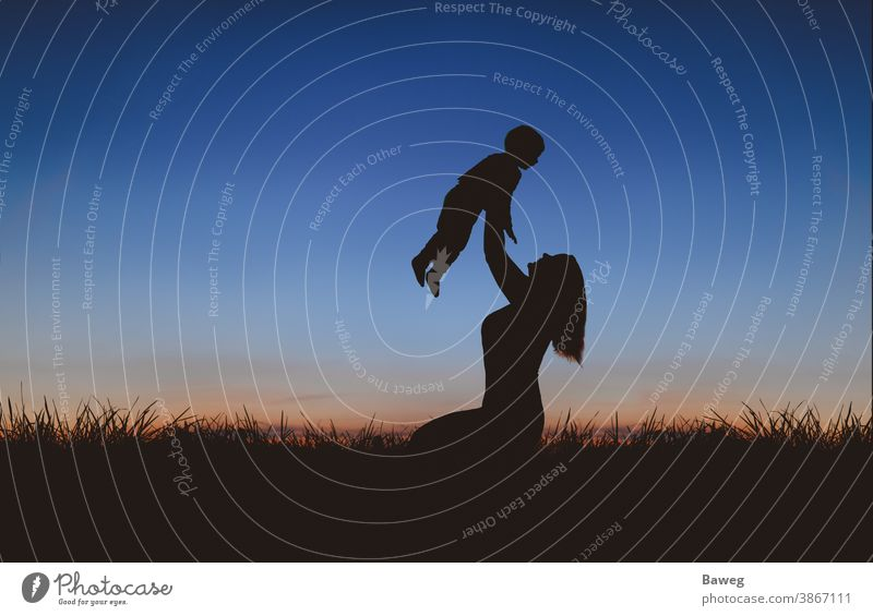 Silhouette of mother and son at sunset silhouettes time-out Tree Sunrise Sunset Family Woman Mother Son Child relation Matrimony relaxation free time Joy Peace
