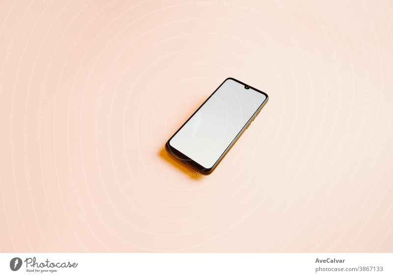 Flat pink background with a mobile phone with a white screen and copy space to write on phones copy-space selection tech listen multimedia workplace middle