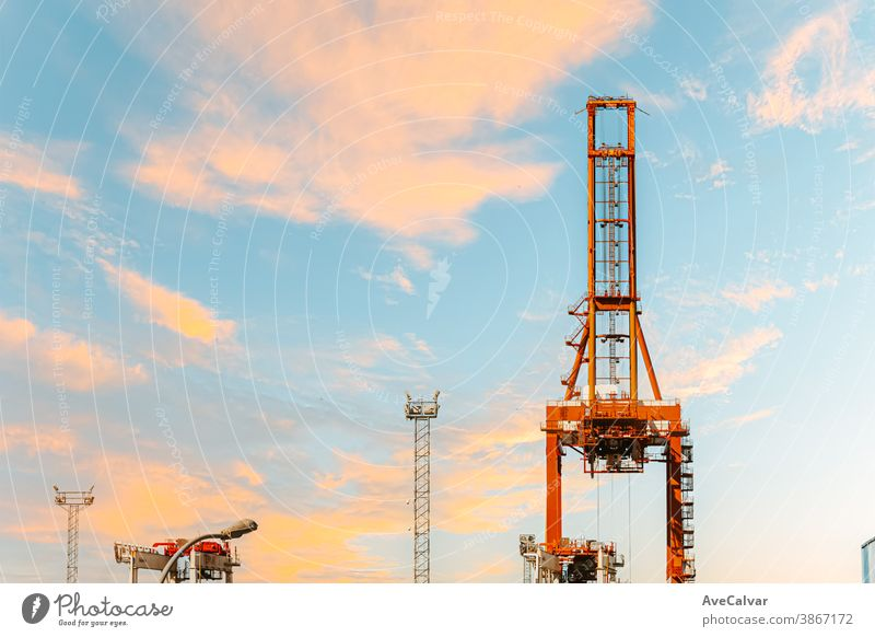Horizon of some islands under a colorful sunset with a relaxing seascape lifting work industry site sunrise project silhouette development high industrial