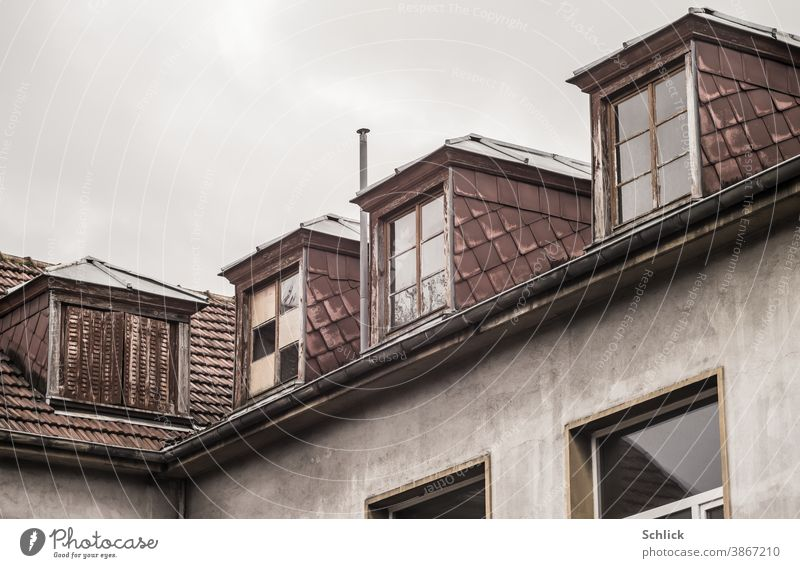 Dormer windows with asbestos fibre cement boards of an old school building Roof Dormers Old dilapidated Wooden window Asbestos fibre cement boards facade panels
